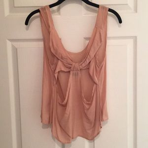 Light pink tank with open back design
